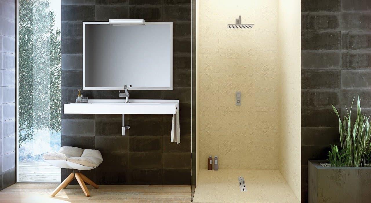 cuarto de baño con lavabo espejo y plato de ducha de color crema claro