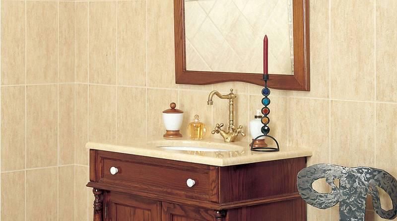 cuarto de baño con mueble pequeño de madera con lavabo y paredes ceramicos color camel