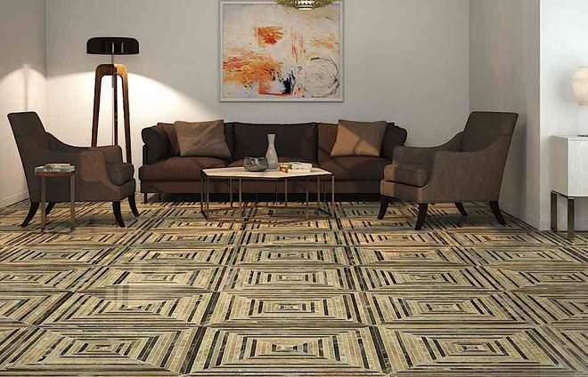 sala de estar con sofas y butacas marrones, un cuadro y mesita baja. suelo imitacion piedra con formas cuadradas