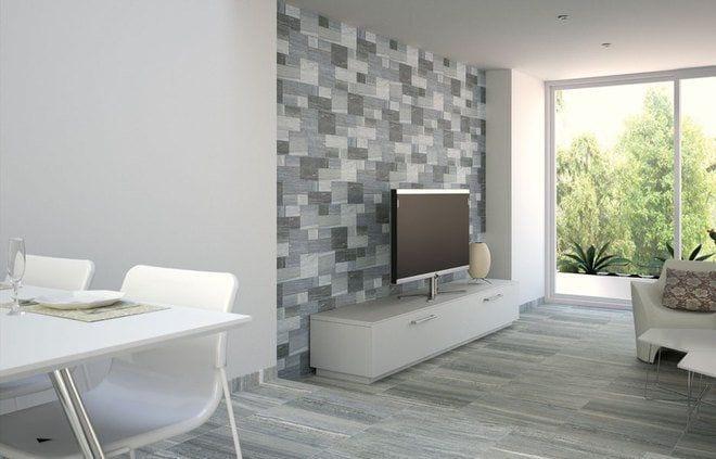 salon con muebles blancos y pared y suelo imitando a la piedra de tonos grises