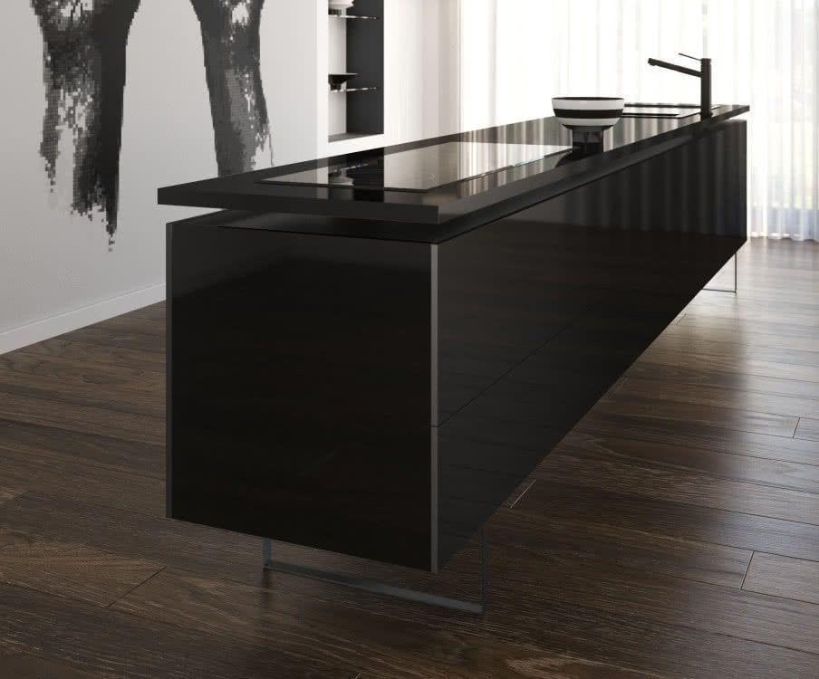mueble con encimera de silestone color iconic black con una placa vitroceramica y grifo en un aestancia con suleo de madera