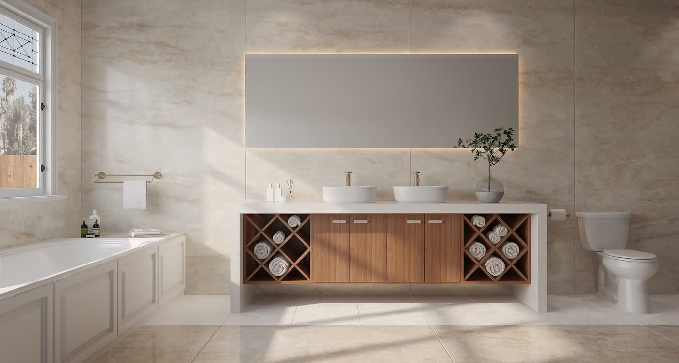 baño con mueble de madera y toallas enrolladas en su interior, encima dos lavabos, una planta y un gran espejo. el suelo y las paredes son de dekton modelo arga