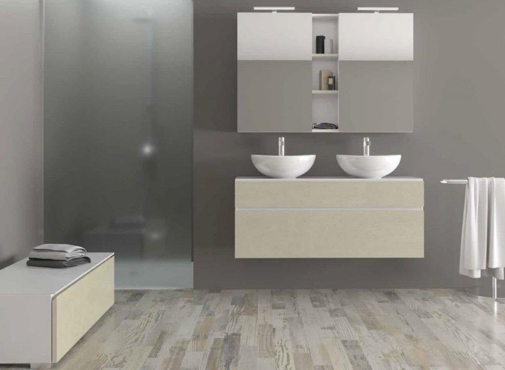 mueble de baño color crema con dos lavabos redondos blancos y 2 muebles auxiliares encima