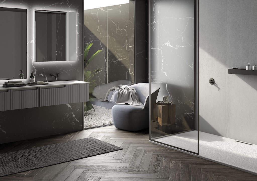 mueble de baño color gris y dos espejos encimas, al lado una mampara de ducha